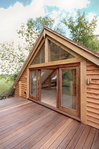 Room above oak garage, sliding doors with balcony